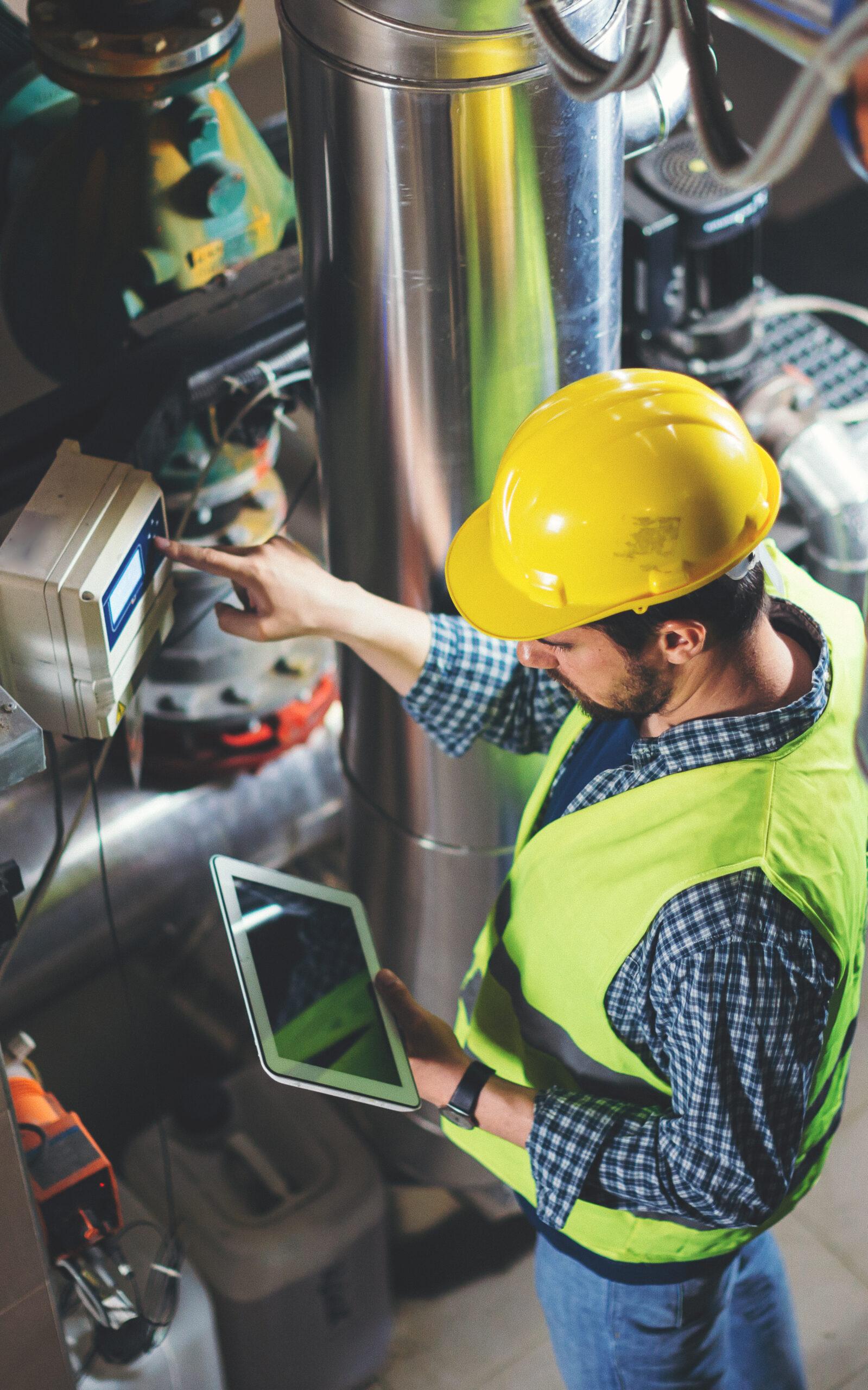 Inspector checking equipment to establish asset reliability
